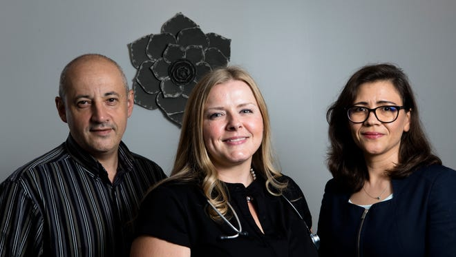 Lotus Health LLC partners, from left, Michael Spivak, Nurse Practitioner, Tearea Roland, Nurse Practitioner, and Dr. Naila Goldenberg, Endocrinologist, stand inside the Lotus Health LLC on June 26, 2018, in Mason.