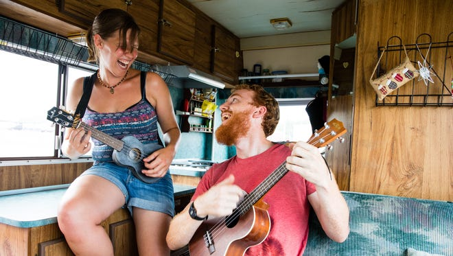 Route 66 connects people from all across the globe. Travelers Natalie Rayner and William Barnett play the ukulele inside their RV as they venture across the Main Street of America.