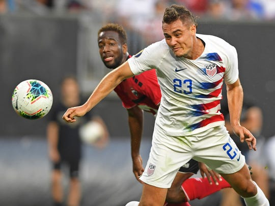U.S. defender Aaron Long heads the ball in for a goal during the first half of the team's CONCACAF Gold Cup soccer match against Trinidad and Tobago, Saturday, June 22, 2019, in Cleveland. (AP Photo/David Dermer)