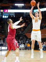 Tennessee's Lew Evans shoots a three over Alabama's