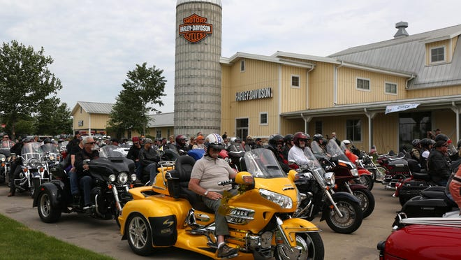 About 300 motorcycles lined up at Big Barn Harley-Davidson, 81 N.W. 49th Place in Des Moines, for the 2015 Roast and Ride on Saturday. The riders then traveled to the Central Iowa Expo near Boone.