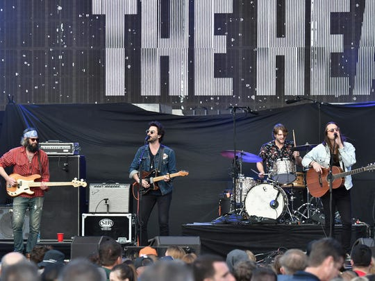 Chris Zasche, Jonathan Russell, Tyler Williams and Josiah Johnson of the band The Head and the Heart perform at the AT&T Block Party during the NCAA March Madness Festival at Margaret T. Hance Park on March 31 in Phoenix, Arizona.