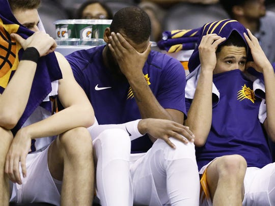 Suns players react on the bench in their loss to the Rockets on Thursday.