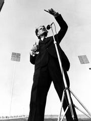 Evangelist Billy Graham makes a point to the crowd at Liberty Bowl Memorial Stadium on May 8, 1978. The stadium crowd was one of two to hear Graham. Inclement weather forced the crusade to the Coliseum, but when the clouds lifted, Graham went to the stadium to speak to those who could not get in the Coliseum.