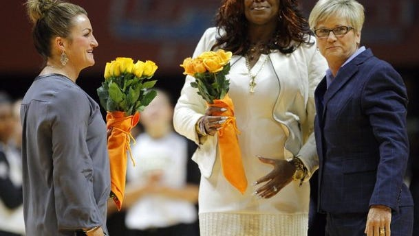Tennessee assistant coach Bridgette Gordon, center, visited UT as a Wichita State assistant in 2014. She and former Shockers coach Jody Adams, left, were presented flowers by Lady Vols coach Holly Warlick.