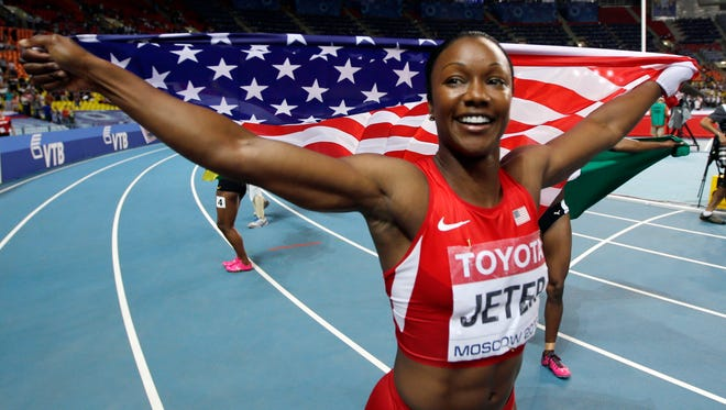 United States' Carmelita Jeter poses for photographers after winning the bronze medal in the women's 100-meter final at the World Athletics Championships in the Luzhniki stadium in Moscow, Russia. Jeter's torn quadriceps? Much better. Tyson Gay's reputation? Still under repair. Two of the top American sprinters have some mending to do at nationals this weekend in Eugene.