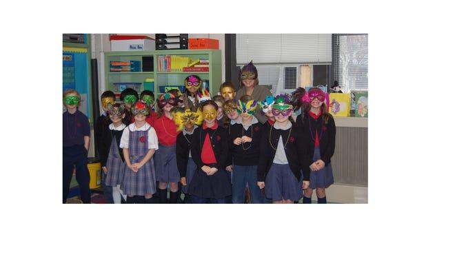 Bishop Schad Regional School celebrated Mardi Gras on Feb. 9. Sue Bencie's third-grade class wore their Mardi Gras masks for the celebration.