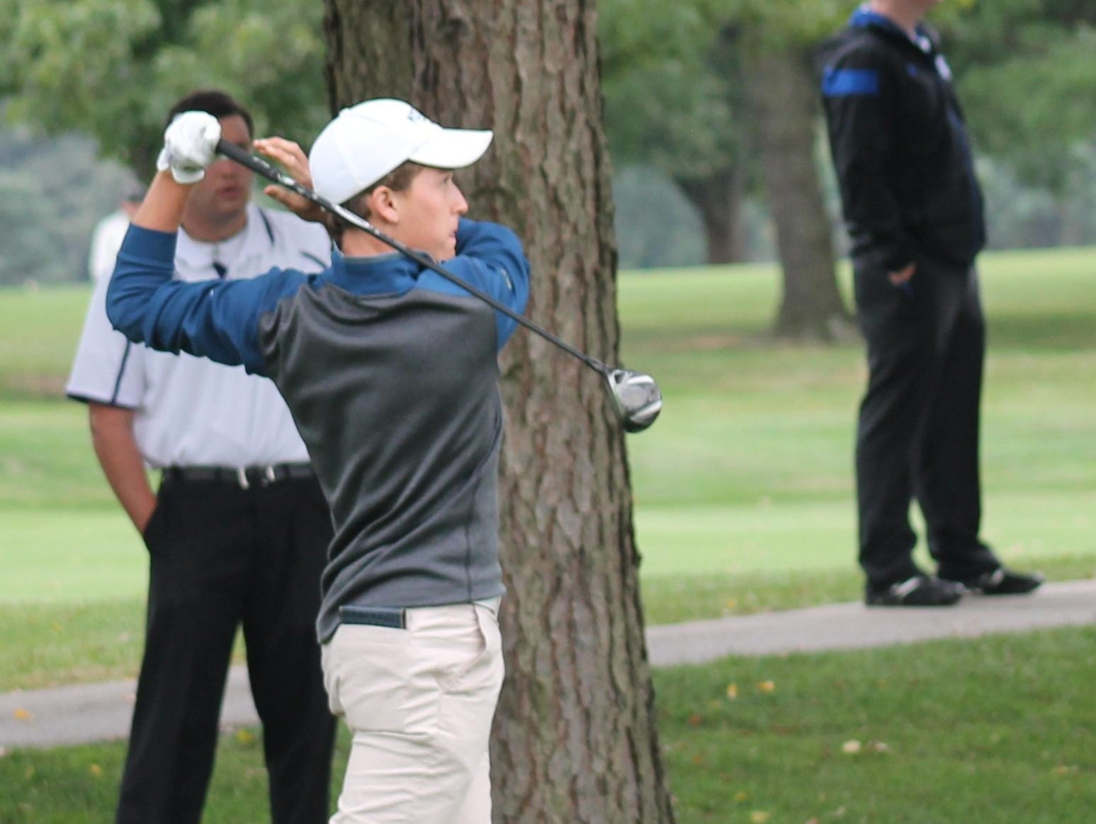 Moeller's Jake Fox follows through on his tee shot Sept. 16, 2014, at a GCL Quad meet at Kenwood.