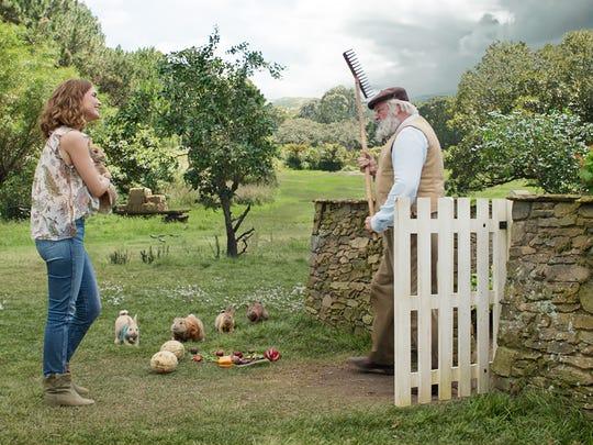 "Bea (Rose Byrne) talks to Mr. McGregor (Sam Neill) in ""Peter Rabbit."""