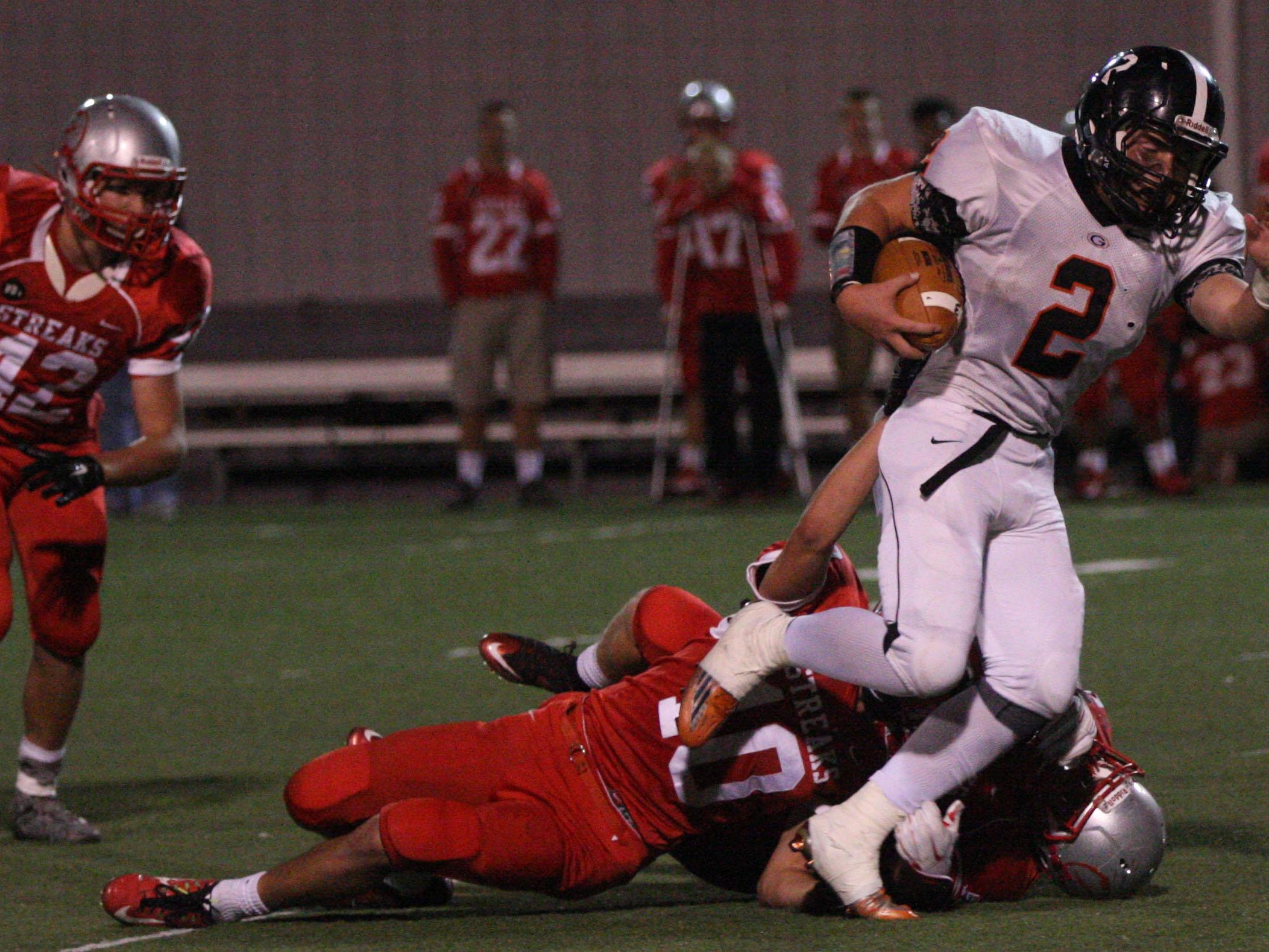 Gibsonburg receiver Erik Jahna breaks free from two St. Joseph Central Catholic defenders on his way to a touchdown Saturday night.
