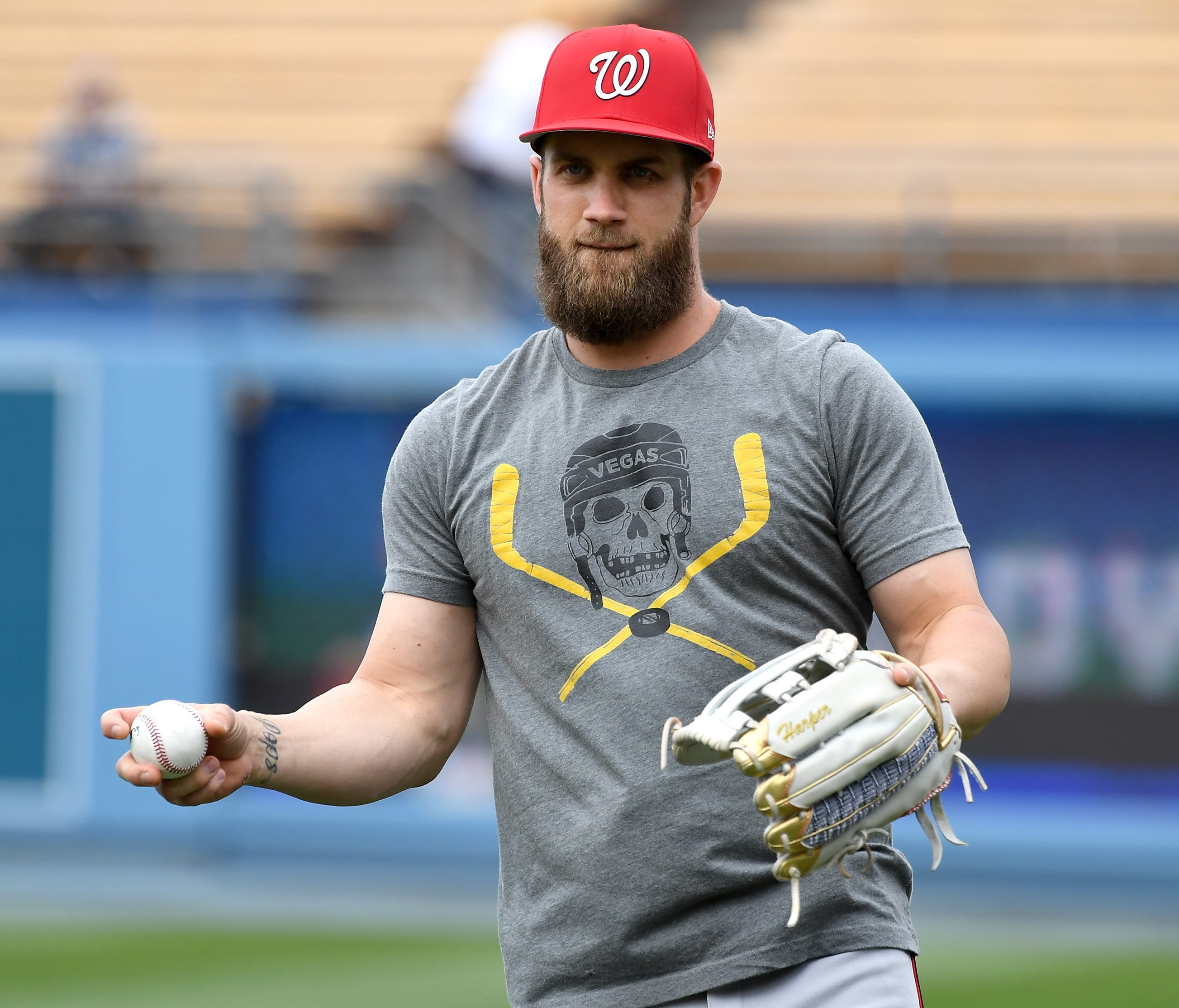 Bryce Harper wears a Golden Knights T-shirt during batting practice last month.