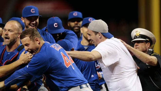 Dylan Cressy (in white) rushes the field to join in the Cubs' celebration of Jake Arrieta's no-hitter before being arrested.