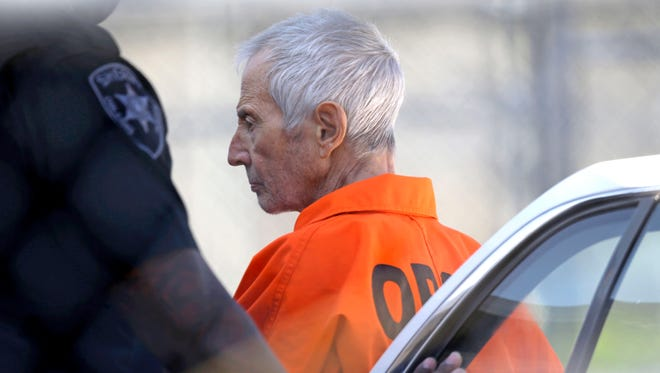 Robert Durst is escorted into Orleans Parish Prison after his arraignment in New Orleans on March 17, 2015. Durst was rebooked on charges of being a convicted felon in possession of a firearm, and possession of a weapon with a controlled dangerous substance, a small amount of marijuana.