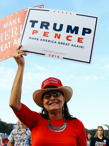Donald Trump supporters wait for him to speak at the Tallahassee Automobile Museum on Tuesday, October 25, 2016.