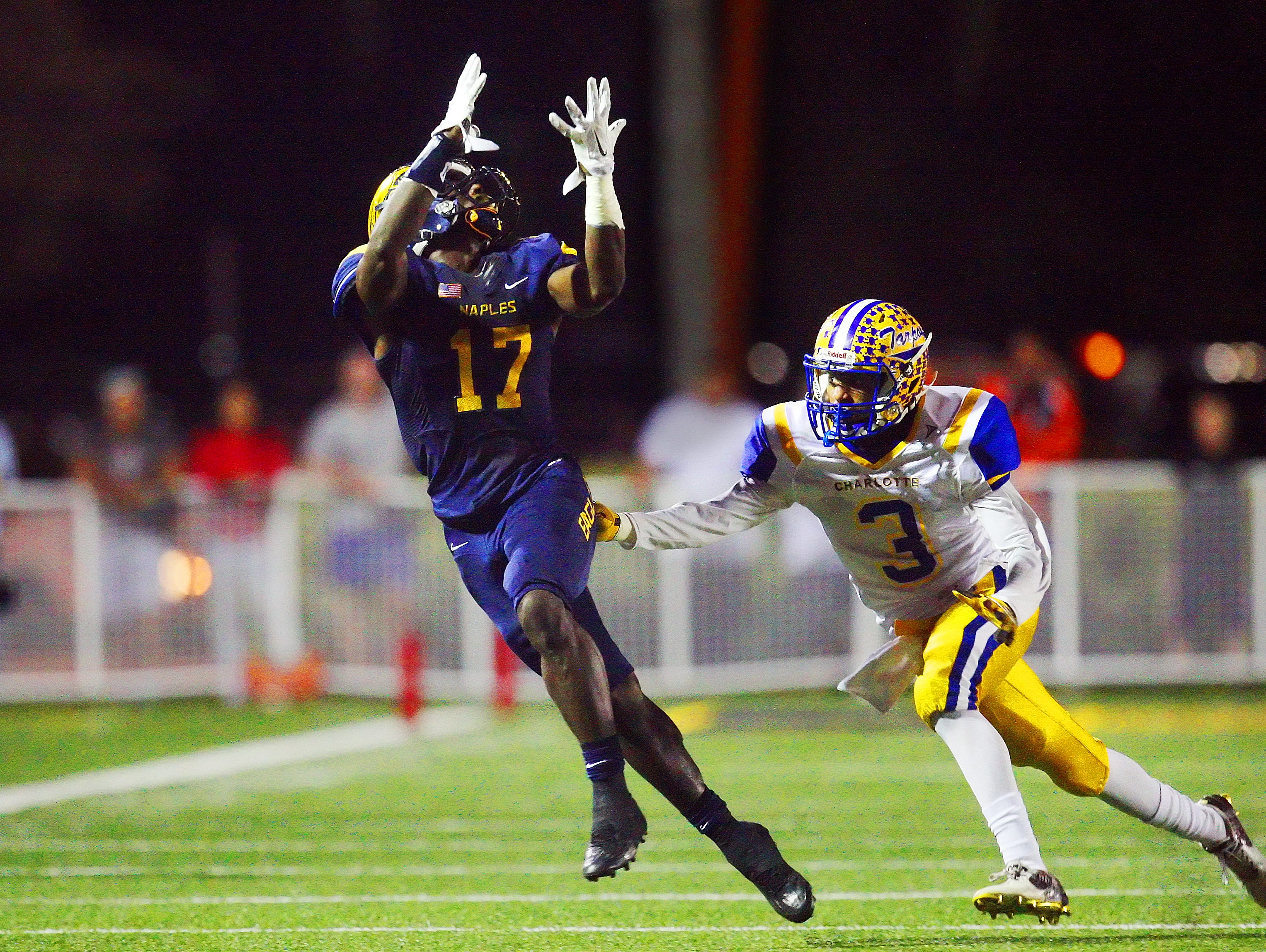 Naples High School's Tyler Byrd leaps for a pass against Charlotte during the Class 6A Region 3 final Friday at Naples High School. Naples beat Charlotte 35-0.