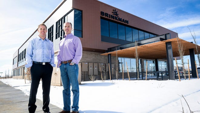 Kevin Brinkman, left, and Paul Brinkman founded Brinkman Partners more than a decade ago. The company is now employee owned and recently became a B Corp, committing itself to high social standards.
