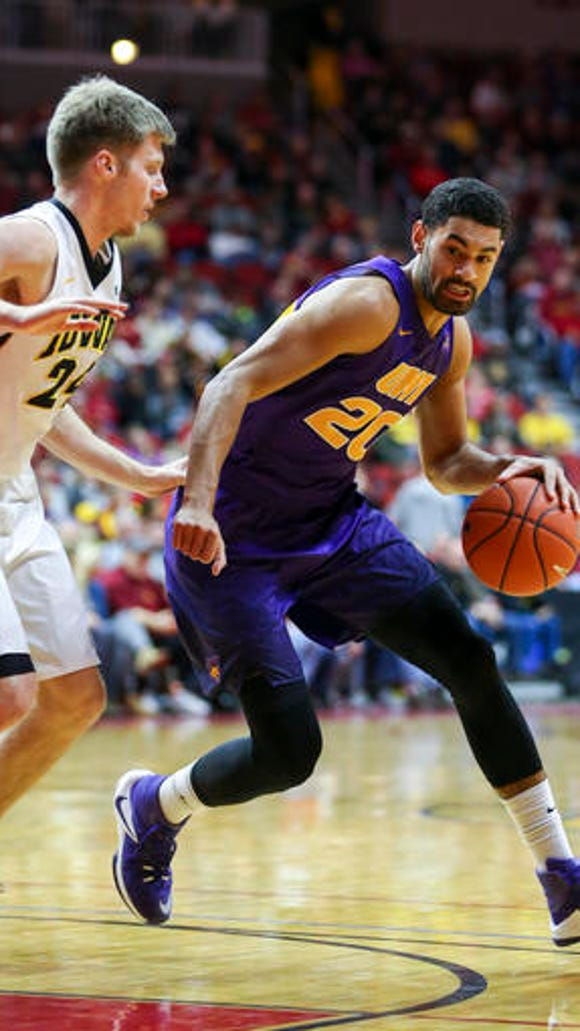Northern Iowa guard Jeremy Morgan tries to drive past Iowa guard Brady Ellingson Dec. 17 in Des Moines, Iowa. Morgan was voted the Preseason Missouri Valley Conference Player of the Year.