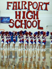 Fairport cheerleaders during the game against Webster Thomas in the second quarter at Fairport High School.