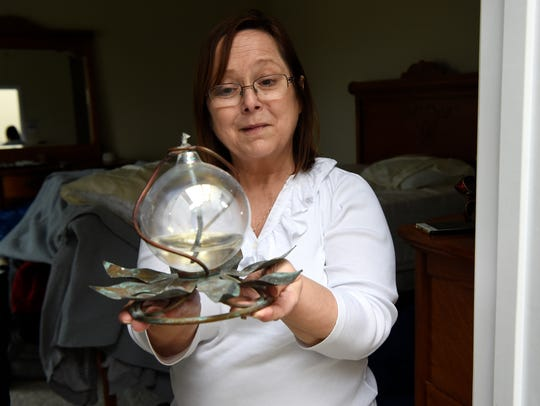 Ruth Laurent is happy that her kerosene lamp, a personal