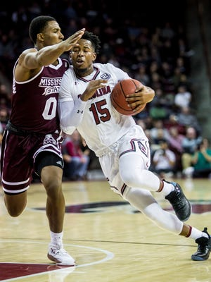 Jan 31, 2018; Columbia, SC, USA; South Carolina Gamecocks guard Wesley Myers (15) is fouled on a drive to the basket by Mississippi State Bulldogs guard Nick Weatherspoon (0) in the first half at Colonial Life Arena. Mandatory Credit: Jeff Blake-USA TODAY Sports