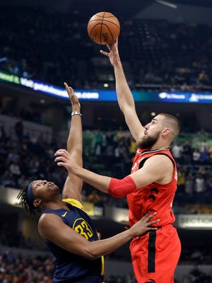 Toronto Raptors' Jonas Valanciunas shoots over Indiana Pacers' Myles Turner during the first half of an NBA basketball game Thursday, March 15, 2018, in Indianapolis.