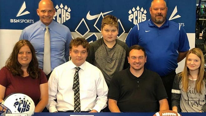 Joining Noah Hudgins (second from left) in the front row at Wednesday's ceremony were his parents, Lisa and Barry Hudgins, and his sister, Abigail. The back row, from left, included Polk County head coach Bruce Ollis, brother Jacob Hudgins and Polk assistant head coach Jamie Thompson.