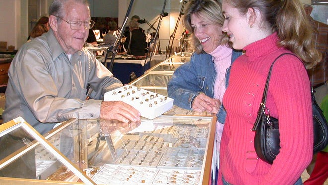 Bruce Lane, from left, shows his jewlery to Gloria Ryan and Kristen Zerega at the gem show held at the Vero Beach Community Center in  Feb. 2004.
