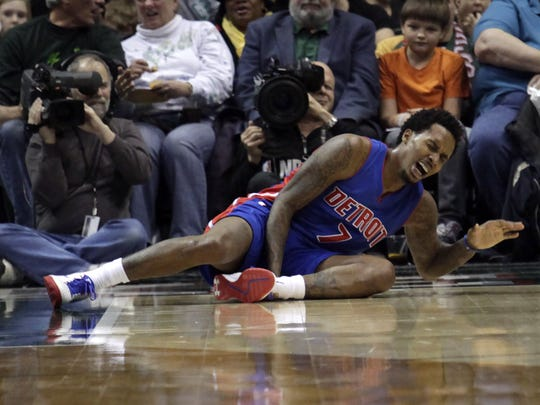 Pistons guard Brandon Jennings shouts after falling to the floor while playing against the Milwaukee Bucks during the second half on Jan. 24, 2015, in Milwaukee.