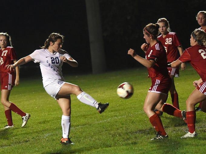 Granville senior Sarah Gravitt scores a goal off of
