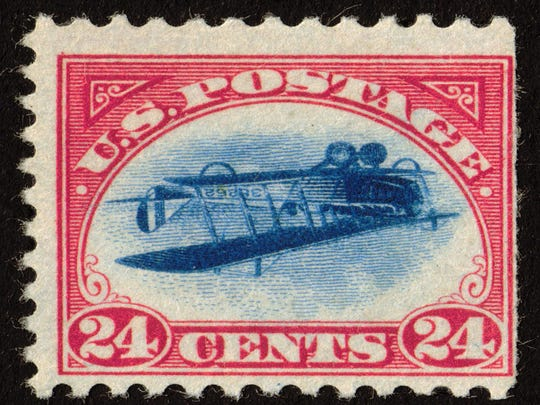 """In 1918, the U.S. Postal Service printed a 24-cent airmail stamp with a picture of aCurtiss JN-4 """"Jenny"""" flying upside down."""