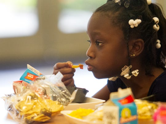 Terrhya Hodge tries the tex mex meal provided for students