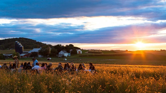 Food fans gather for an open-air dinner at a farm in Pennsylvania. A similar event will be held in Cedar City on July 25, 2018.