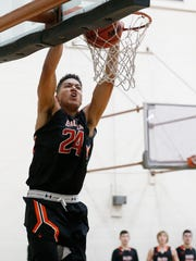 Balboa School's Christian Wilson slams the ball through the hop on a break away dunk during second day action in the 2017 McDonald's Classic Basketball Tournament being held at Del Valle High School. Balboa the defending champ of the tournament came from behind to take the game from NFL Yet 71-50.