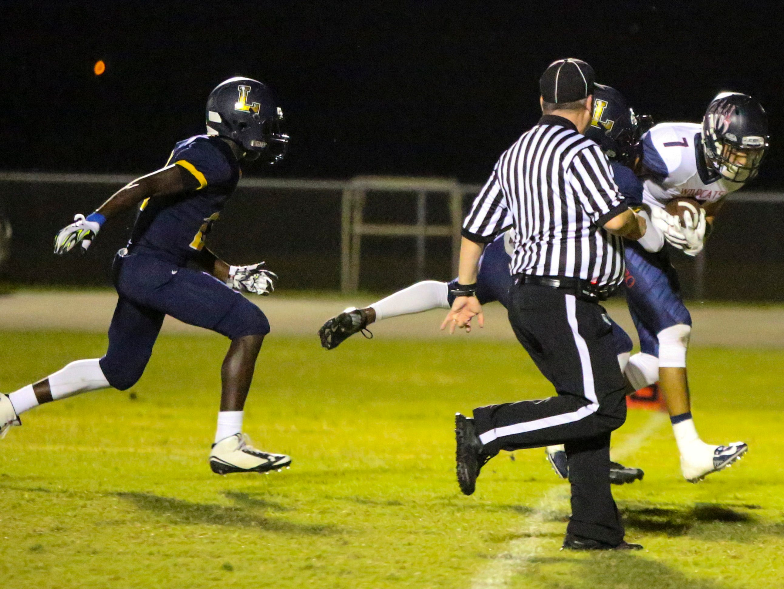 Ester's JC Correll makes the catch to score early in their game against Lehigh. Estero went on to win 21-7.
