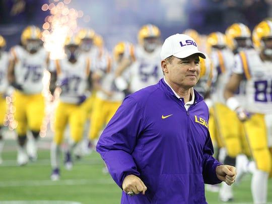 LSU Tigers head football coach Les Miles runs onto the field before playing Texas Tech.