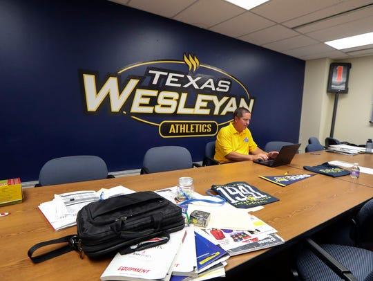 Texas Wesleyan head coach Joe Prud'homme works in a