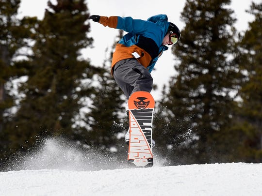In this Nov. 21, 2016, photo, Miles Forgy, of Longmont, Colo., catches some air during the opening day at Eldora Mountain Resort outside Nederland, Colo. Snowpack totals were encouraging across most of the region Wednesday, Dec. 28.