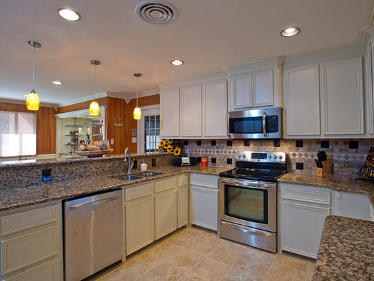 A completely remodeled kitchen boasts stainless steel