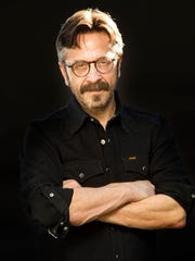 Comedian and podcast host Marc Maron performs on stage