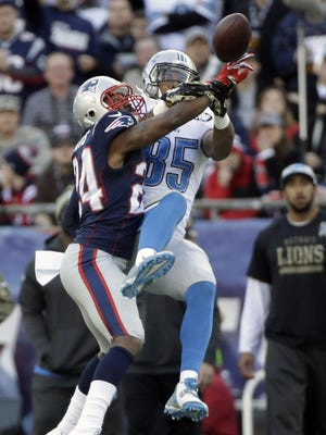 New England Patriots cornerback Darrelle Revis (24) breaks up a pass intended for Detroit Lions tight end Eric Ebron (85) in the second half Sunday, Nov. 23, 2014, in Foxborough, Mass. The Patriots won 34-9.