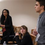 Poudre's Asmita Jha, left, and Fossil Ridge's Allison Hartman look toward Fossil Ridge's Joseph Bolduc as he answers to an objection during a mock trial tournament Friday, Feb. 27, 2015 at the Larimer County Justice Center in Fort Collins, CO.