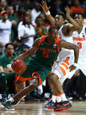 Miami Hurricanes guard Davon Reed dribbles against Andrew White III of the Syracuse Orange during the second round of the ACC Basketball tournament  at the Barclays Center on March 8, 2017 in New York City.