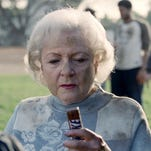 Still of Betty White in hilarious Snickers spot during Super Bowl XLIV.