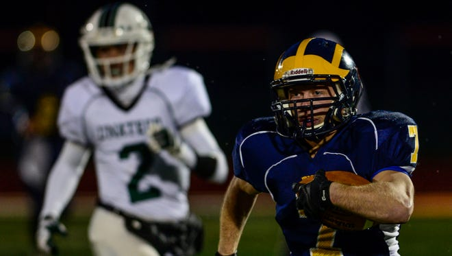 Tioga's Jesse Manuel, shown in last year's Section 4 Class D final against Unatego, has rushed for more than 7,000 career yards and leads the Tigers into Friday's sectional quarterfinal against Oxford. The Tigers beat Oxford last week in the regular-season finale, 43-26, with Manuel rushing for 177 yards and two scores.
