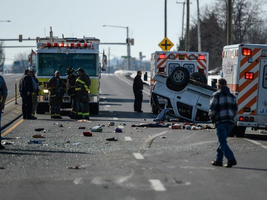Emergency crews work at the scene of a two-vehicle crash with rollover on Route 22 and Route 343 in Bethel Twp. on Tuesday, Feb. 2, 2016.