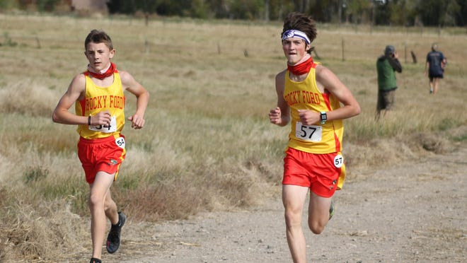 Rocky Ford High School's Caden Miller (left) and Josh Snyder run at the Salida Invitational on Saturday. Miller finished in 10th place and Snyder was 11th.