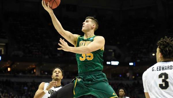 Vermont's Payton Henson (35) drives to the basket against Purdue during the first round of the NCAA tournament at BMO Harris Bradley Center in March. Henson and the Catamounts return to the Bradley Center to play Marquette on Tuesday night.
