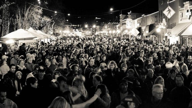 Thousands of people gather on Whiskey Row in Prescott to ring in the new year at the Boot Drop.