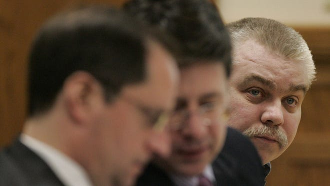 Steven Avery listens to testimony while his defense attornies Jerome Buting (left) and Dean Strang (center) confer in the courtroom in 2007 at the Calumet County Courthouse in Chilton, Wis.