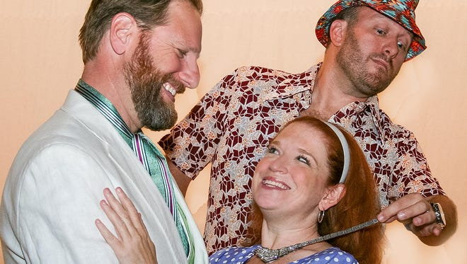 """Chris Steinmayer (Oak Park), Deb Dworkin (Berkley), and Dan Hartley (Grosse Pointe) rehearse for a scene in """"Dirty Rotten Scoundrels"""" the musical at St. Dunstan's Theatre in Bloomfield Hills. Show runs through Oct. 29."""
